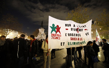 "A protest in Paris on 26 November against the ban on public gatherings introduced after the attacks in the city. The banner reads ""No to the state of emergency"", ""The emergency concerns social and climate issues""."