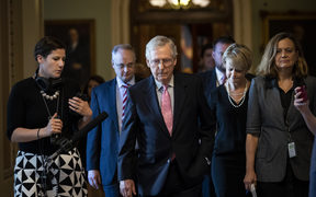 Senate Majority Leader Mitch McConnell  leaves the Senate floor and walks to his office on Capitol Hill.