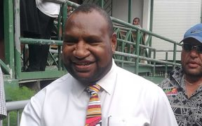 Papua New Guinea government MP James Marape outside the national court in Waigani after an electoral petition against him was dismissed.