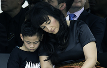 Jonah Lomu's wife and son at his memorial service at Eden Park