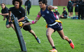 Whanganui City College playing Te Kura o Nga Tapuwae (black uniform) from Mangere in South Auckland.
