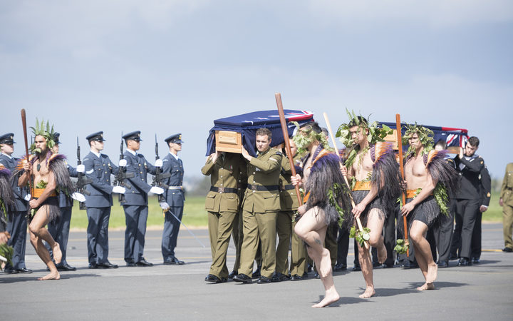 The he taua (war party) leads the caskets towards the awaiting families of the two soldiers.