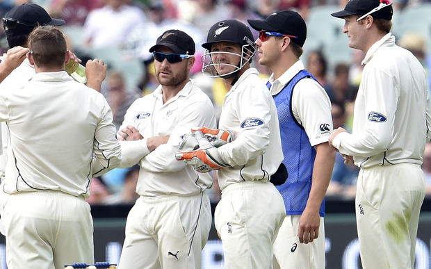 New Zealand captain Brendon McCullum, second left, and wicketkeeper BJ Watling wait for the decision over Australian batsman Nathan Lyon's sweep-shot.