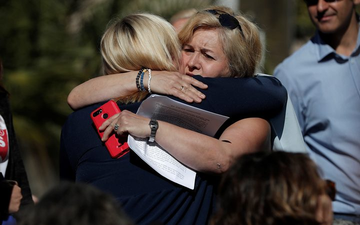 Ines Madrigal (left), 49, who was taken away from her mother as a newborn in 1969, is seen hugging someone after the baby trafficking trial.
