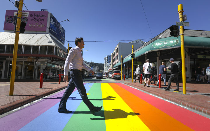 Wellington Major Justin Lester crossing the new rainbow crossing, Cuba Street in Wellington.