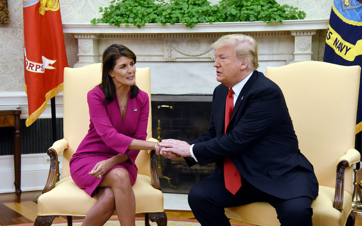 US President Donald Trump shakes hands with Nikki Haley, the United States Ambassador to the United Nations in the Oval office.