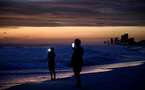 People visit the beach while waiting for Hurricane Michael in Panama City Beach, Florida.