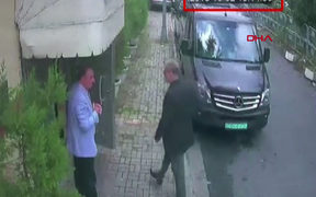 CCTV footage obtained from Turkish news agency DHA shows Saudi journalist Jamal Khashoggi (R) arriving at the Saudi Arabian consulate in Istanbul on 2 October, 2018.