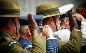 Members of the NZDF saluting at Armistice Day commemorations in Auckland in 2015