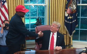 US President Donald Trump meets with rapper Kanye West in the Oval Office.