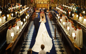 Britain's Princess Eugenie of York (C) walks up the aisle to marry Jack Brooksbank during their wedding ceremony in St George's Chapel, Windsor Castle.