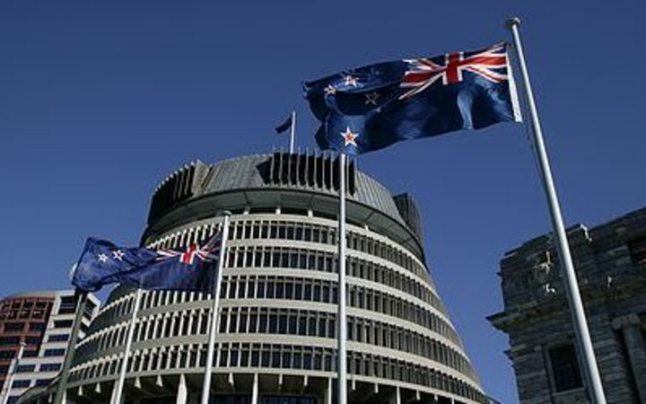 New Zealand flag and Beehive.