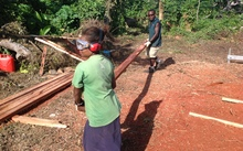 Villagers on Tanna Island in Vanuatu learn to mill their own timber as part of the cyclone rebuild.