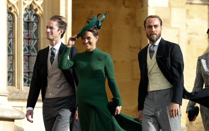 Philippa Matthews Middleton (centre), James Middleton (right), and Pippa's husband James Matthews (left) arrive to attend the wedding of Britain's Princess Eugenie.