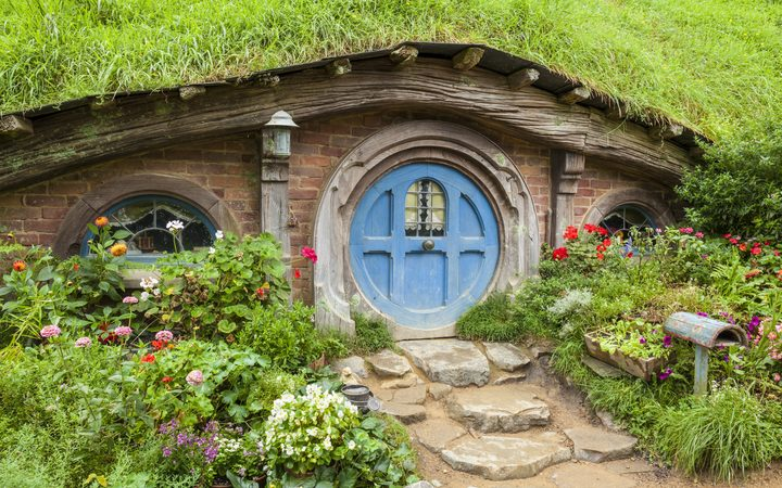 Wooden doors of Hobbit holes in the film set of Hobbiton in Matamata.