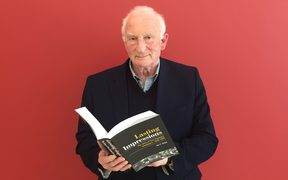 Ian F Grant with his new book covering 80 years of new Zealand newspaper history.