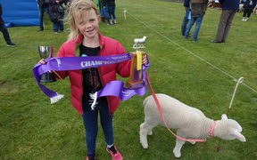 Overall champion Celia Gribble, 8, and Popcorn.