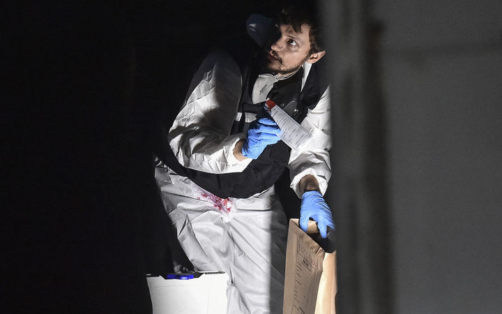 A Turkish forensic police officer searches for evidence at the Saudi Arabian consulate on October 17, 2018 in Istanbul.