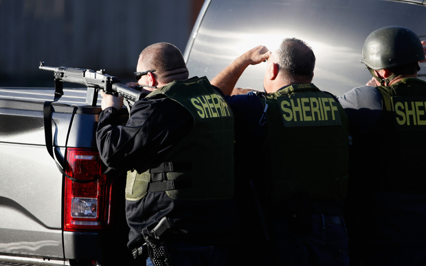 San Bernadino Sheriff officers pursue suspects of the shooting at the Inland Regional Center on 2 December 2015 in San Bernardino, California.