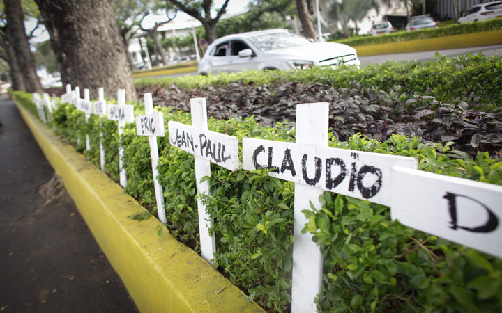 Crosses bearing names of victims set in front of Papeete Court house, on the first day of the trial of Air Moorea company, 11-years after the crash of one of its aircrafts in which 20 people were killed.