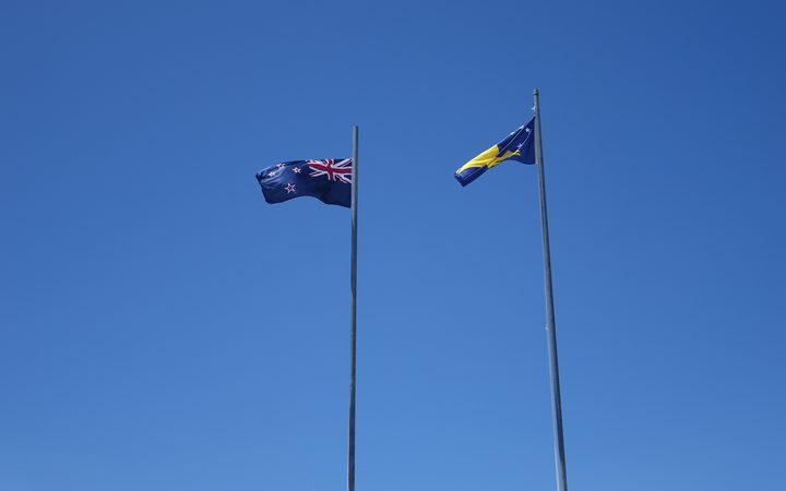 Tokelau and New Zealand flags flying in Atafu, Tokelau