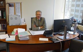 Chief Judge Wilson Isaac, the chair of the Waitangi Tribunal, sitting at his desk in Wellington.