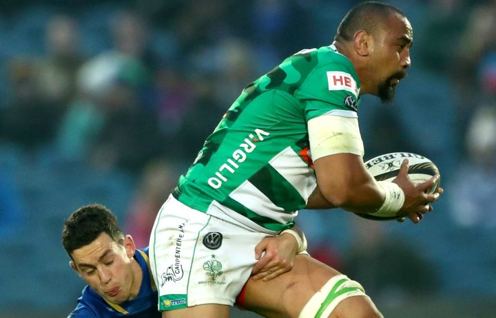 Benetton Treviso's Nasi Manu attempts to evade the tackle of Leinster's Noel Reid.