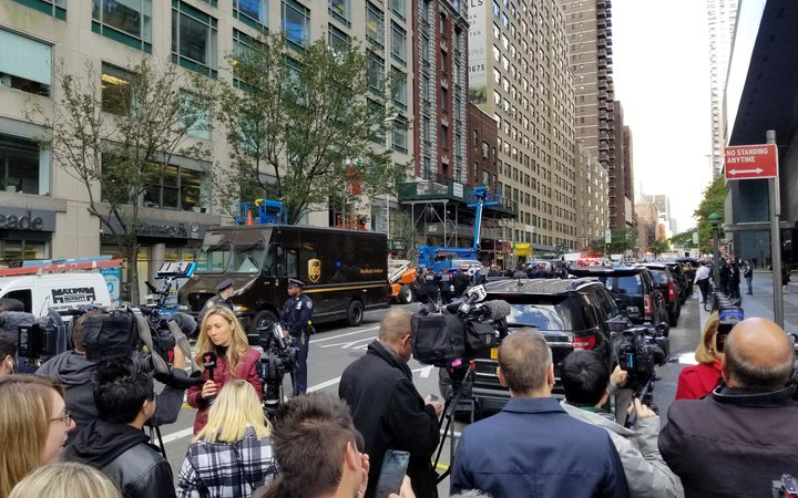 Police officers take security measures in front of the Time Warner Building where a suspected explosive device was found in the building after it was delivered to CNN's New York bureau in New York.