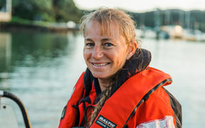 Dr Ingrid Visser aboard her boat in Mill Bay, Mangonui Harbour, Northland