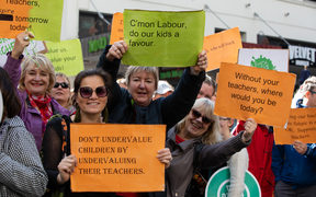 Teachers march on Queen Street in a bid for better pay rates.