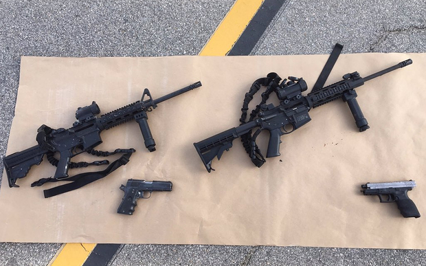 This image obtained from the San Bernardino County Sheriff, shows weapons carried by the suspects
