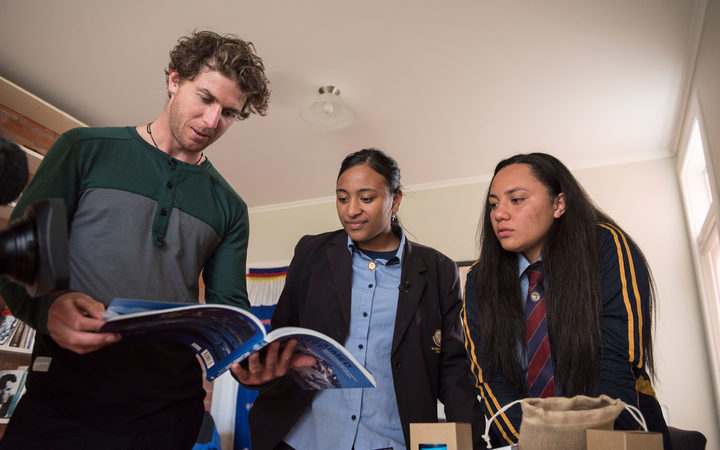 Olympic  kayaker  Mike  Dawson  and  selected  SEHC  students  Mele  Fetu'u  and  Lana  Kiddie-Vailook  through  Antarctic  resources  in  Sir  Edmund  Hillary's  old  study  inside  Hillary  House  Leadership  Centre