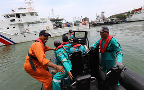 Members of a rescue team prepare to search for survivors from the Lion Air flight JT 610, which crashed into the sea.