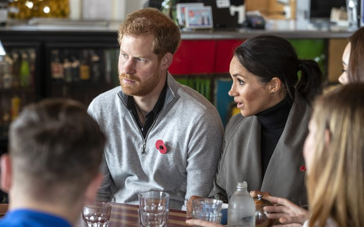 Prince Harry and his wife Meghan meet with representatives of mental health projects at Maranui cafe in Wellington.