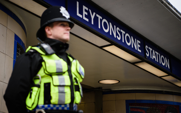 A policeman stands guard at Leytonstone Station