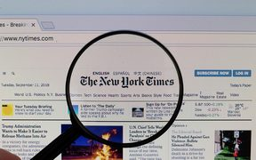 The New York Times logo on a computer screen with a magnifying glass (Flickr user Marco Verch CC BY 2.0)