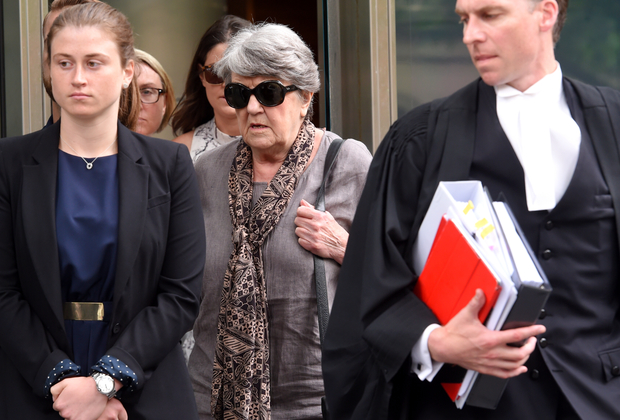 Maggie Kirkpatrick (centre) leaves the County Court in Melbourne, Monday, Dec. 7, 2015.