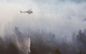 Four helicopters used monsoon buckets to fight the blaze.