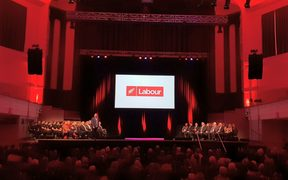 The red-lit Dunedin Town Hall, the venue for  this year's Labour party conference.