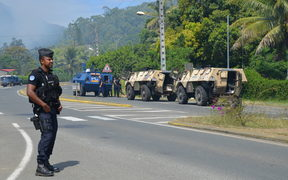 Police on the blocked road south of Noumea near St Louis in New Caledonia