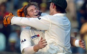 Warne celebrates with Adam Gilchrist Madras 2004.