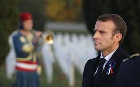 French President Emmanuel Macron stands at the cemetery by the Ossuary of Douaumont near Verdun, northeastern France.