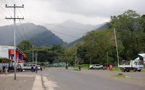People at Alotau town street, hills view, Papua New Guinea, 2011.