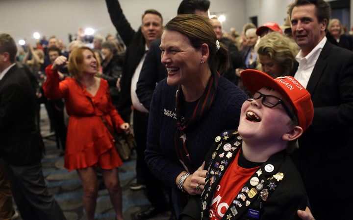 Republican supporters cheer after Incumbent Republican candidate for Iowa's Governor Kim Reynolds won re-election during Iowa's GOP Election Night.