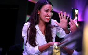 Alexandria Ocasio-Cortez celebrates her victory at La Boom night club in Queen.
