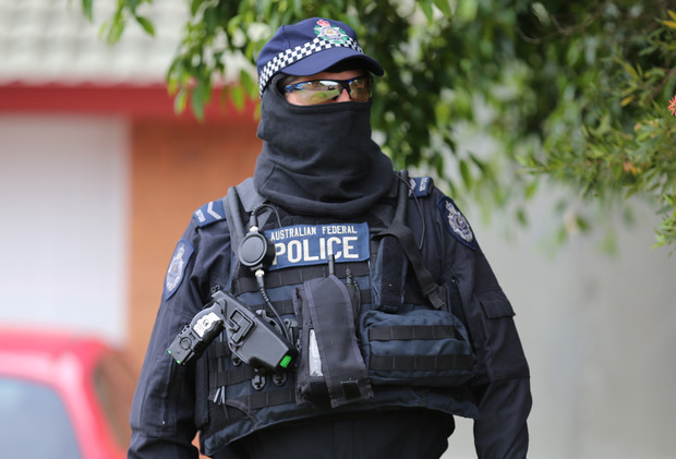 Australian federal police officers during a counter-terror operation at Raby in south-west Sydney on 10 December 2015.