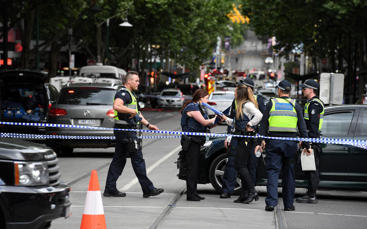 Police cordon off Bourke St following a stabbing incident in Melbourne.