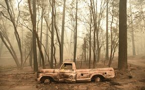 A burnt out truck is seen in Paradise, California after the Camp fire tore through the area.