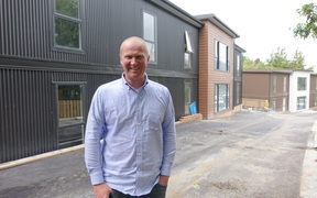 Bus driver and property developer Simon Haslett has helped charity workers move into new residence.