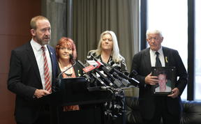 Andrew Little making the announcement at Parliament alongside the families of the men who died in the Pike River Mine.